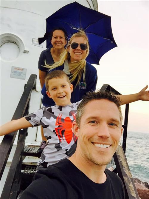 Mr. B, Mrs. B, his son and daughter on a boat